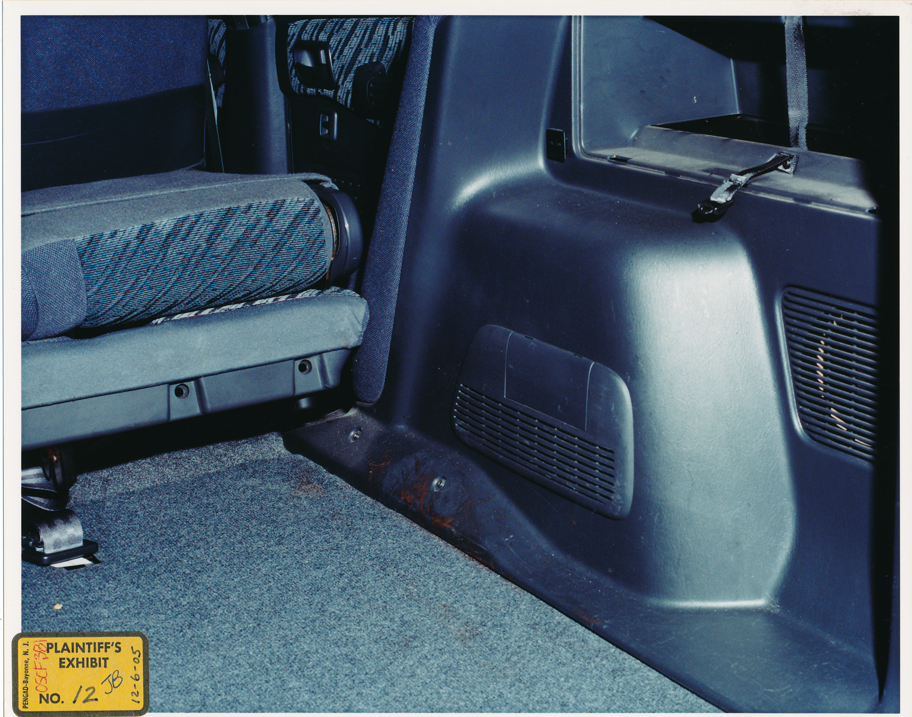 The Blood Stains On Passenger Side Cargo Area Floor Appear To Show A Distinct Line Along Plastic Panel Where Something Was Covering Interior
