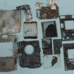 Exhibit 412 - Burnt Cell Phone Pieces